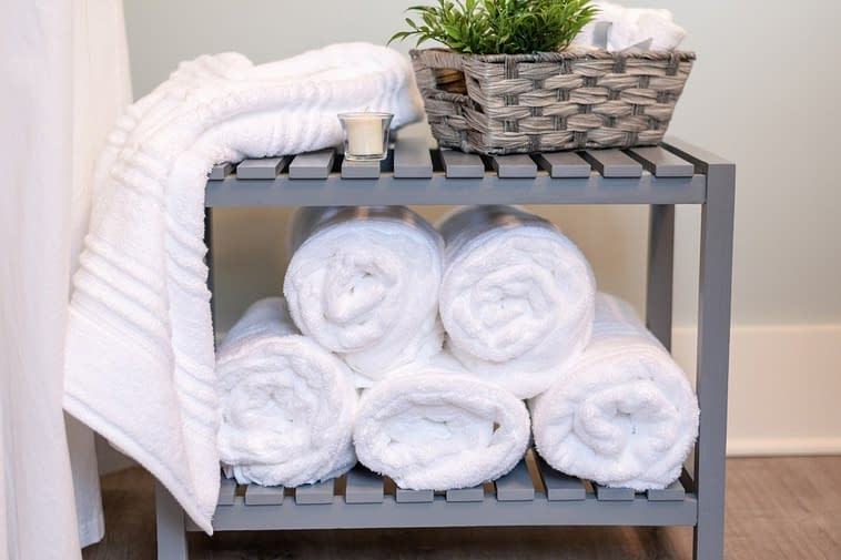 fluffy-white-towels-rolled-and-stacked-bath-bathroom-bath-time-home-decor-spa-style-relaxation-luxury